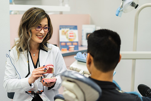 Dr. Lee performing a routine procedure on a patient at Irvine Dentistry